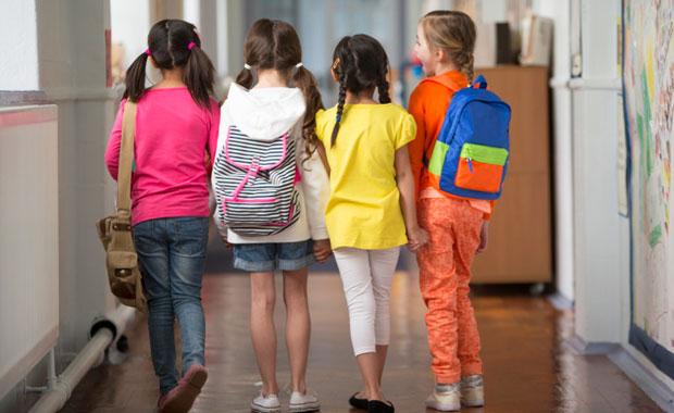 School-aged children walking down the hall